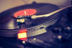 Playing retro music: Professional turn able audio vinyl record music player. Close up picture of a record player, playing a record vinyl music retro vintage royalty free stock photography
