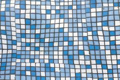 Close up picture of small square blue and white shiny ceramic tiles. Background, bathrooms and pools walls and floor design. Close up picture of small square royalty free stock images