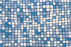 Close up picture of small square blue and white shiny ceramic tiles. Background, bathrooms and pools walls and floor design. Close up picture of small square royalty free stock photography