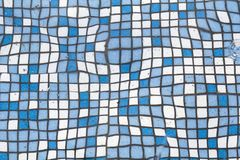 Close up picture of small square blue and white shiny ceramic tiles. Background, bathrooms and pools walls and floor design. Close up picture of small square stock photos