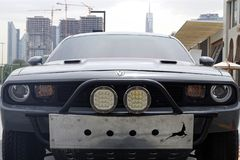 Close-up picture of a sport car Challenger with Dubai skyline in background stock photo