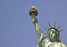 Close up picture of the Statue of Liberty. A close up picture of the Statue of Liberty against a perfect sky Stock Photography