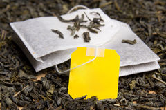 Close up picture of tea bags and dried tea leaves with blank pap Stock Photos