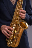 Close-up picture of a trumpet in hands of a jazz Royalty Free Stock Image