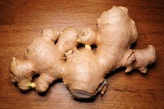 Ginger on oak table. Close up picture of vegetable, Ginger on oak table royalty free stock photos