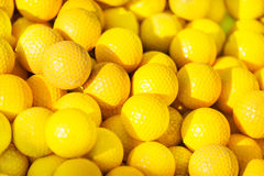 Close-up picture of yellow golf balls pile Royalty Free Stock Image