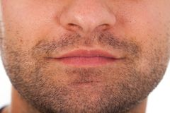 Bristle and mouth macro. Close up picture of young man`s bristle and mouth. Facial hair macro stock photo