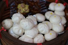 Close-up pictures of Chinese style food, many steamed buns, stacked together in bamboo boxes. royalty free stock photography