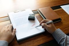 Close-up pictures of the hands of businessmen signing and stamping in approved contract forms vector illustration