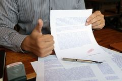 Close-up pictures of the hands of businessmen signing and stamping in approved contract forms royalty free illustration