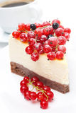 Close-up of piece of cheesecake with red and black currants Royalty Free Stock Photo