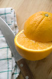 Close up piece of orange. Close up piece of fresh orange and knife Stock Photos