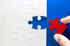 Close up piece of white and one red  jigsaw puzzle  , concept of Royalty Free Stock Photography