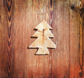 Close up of a piece of wood in the shape of a christmas tree Royalty Free Stock Image