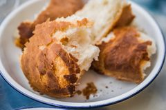 Close up pieces of bread in white bowl. royalty free stock images
