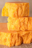 Close up pieces cheddar cheese Stock Image