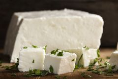 Close up of pieces of cheese with parsley leaves Royalty Free Stock Photography