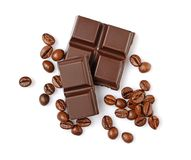 Close-up pieces of dark chocolate bar with coffee flavor and beans Stock Photos
