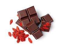 Close-up pieces of dark chocolate bar with dried Goji berries Stock Photography