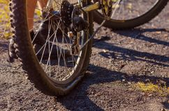 Close-up pierced rear wheel of a sports bike. Problem when driving on rough terrain. Autumn weather Royalty Free Stock Images