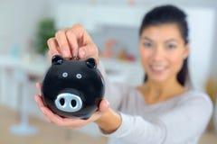Close-up piggy bank in female hands. Close-up of piggy bank in female hands Stock Photos