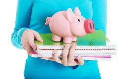 Close up on a piggybank and notebooks Royalty Free Stock Photography