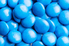 Close up on pile blue milk chocolate candies crisp shell Royalty Free Stock Images