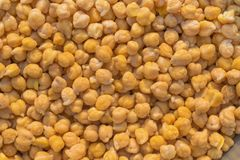 Close up of pile of boiled yellow chick peas stock photos