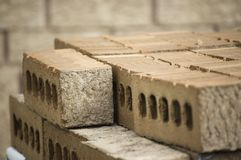 Close up of a pile of bricks. / construction material warehouse stock photos