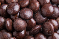 Close up on pile brown milk chocolate candies crisp shell Stock Images