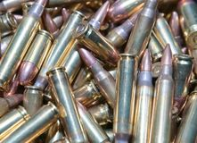 A close up of different calliber bullets. A close up of a pile of .223 and 45 caliber as well as 9mm bulletsn Stock Photos