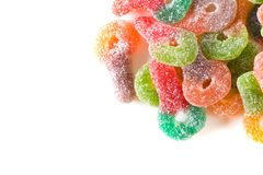 Macro of colorful sugar coated chewy gummy candy. Close up of pile of colourful sugary coated chewy gummy candy. With lots of copyspace stock photo