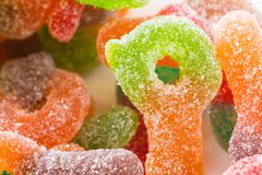 Macro of colorful sugar coated chewy gummy candy. Close up of pile of colourful sugary coated chewy gummy candy stock images