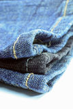 Close up of a pile of denim jeans Stock Image