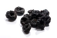 Close-up of pile dried, raw blue plums on white background stock photos