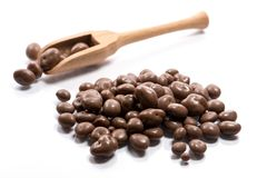 Close-up of pile dried, raw, chocolate raisins in a wooden spoon royalty free stock photos