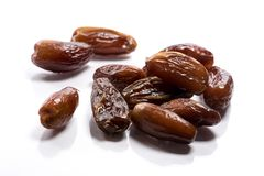 Close-up of pile dried, raw dates on white background royalty free stock images