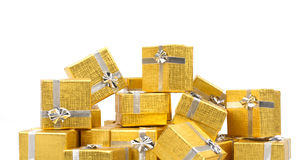 Close up of a pile of gold gifts on white Royalty Free Stock Photo