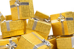 Close up of a pile of gold gifts on white Stock Images