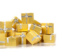 Close up of a pile of gold gifts on white Royalty Free Stock Images