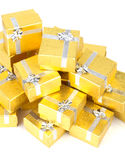 Close up of a pile of gold gifts on white Stock Photo