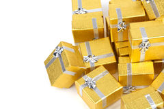 Close up of a pile of gold gifts on white Royalty Free Stock Photography