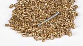 Bronze threaded inserts on white background stock images