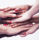 Close-up on a pile of hands on top of each other, multi-ethnic group of people, studio shot Stock Photo