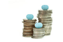 Close up pile of medicine and coin stack Stock Images