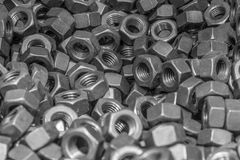 Close-up pile of nuts in spare parts for machinery texture background Royalty Free Stock Photos