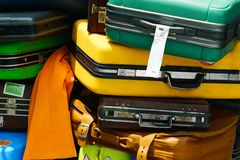 Close up of pile of old travel suitcases luggages stacked for tr. Ansport one above the other in many colors piled up together Stock Photography