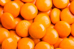 Close up on pile orange milk chocolate candies crisp shell Stock Images