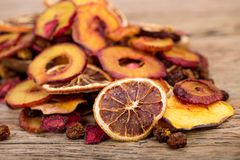 Close Up Of Pile Of Organic Raw Sun Dried Fruits Mix Of Oranges, Plum, Strawberries, Golden Berries And Peach On Wooden Table stock photos