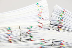 Close up pile overload report place on white background. Close up pile overload report and receipt with colorful paperclip place on white background Royalty Free Stock Image